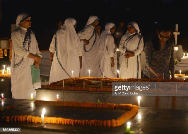 Indian Catholic nuns light candles at the graves of their relatives during All Souls Day in Siliguri on November 2 2017 All Souls Day is observed in...