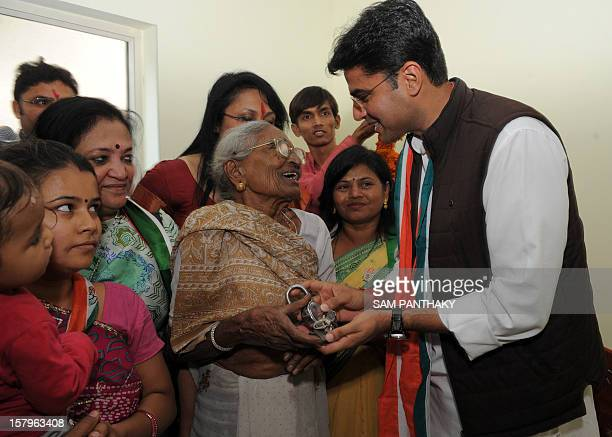 Indian Central Corporate Affairs minister Sachin Pilot inaugurates a sample house at the Gujarat Congress house in Ahmedabad on December 8 2012 The...