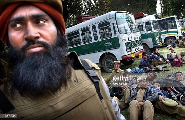Indian Central Reserve Police Force officers wait in an election center September 29 2002 in Pampora a town outside of Srinagar the summer capital of...