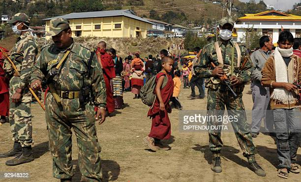Indian Central Reserve Police Force personnel and Buddhist monks are seen during teachings led by Tibetan spiritual leader the Dalai Lama at...