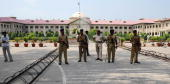 Indian Central Reserve Police Force personnel stand guard at the Allahabad High Court during a strike by Allahabad High Court Bar Association lawyers...