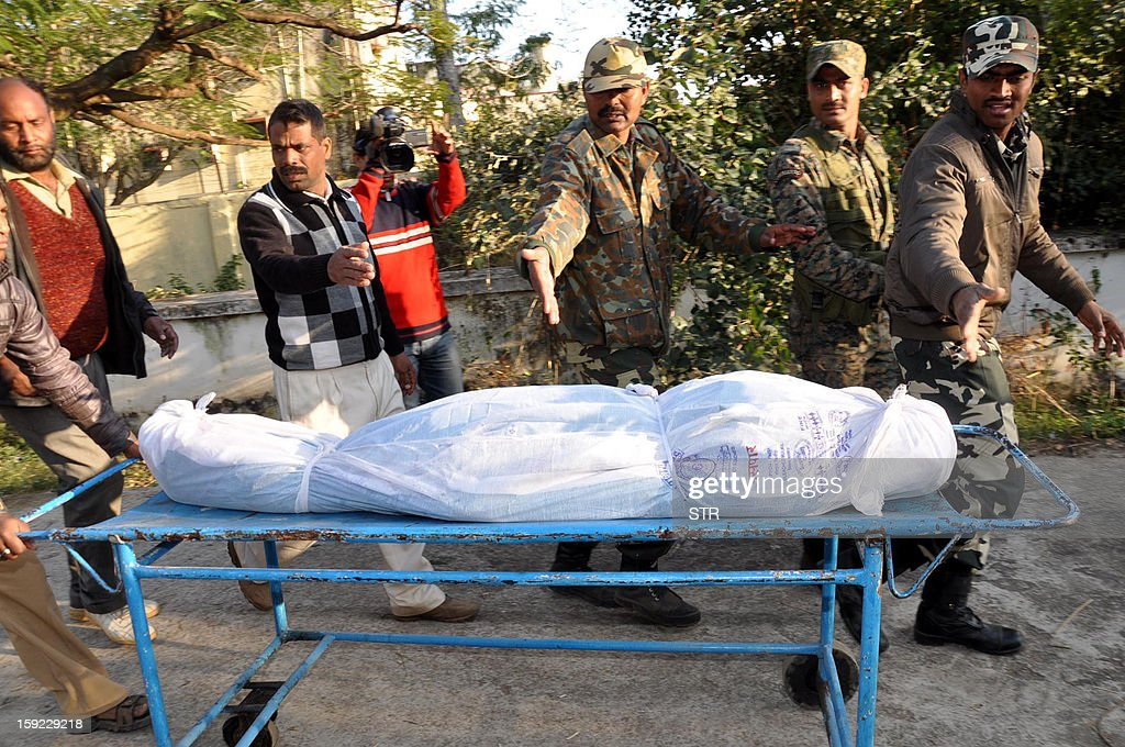 Indian Central Reserve Police Force (CRPF) Soldiers move the body of a jawan - soldier - killed in an encounter with Maoists, at RIMS hospital in Ranchi in eastern Jharkhand state on January 10, 2013. A two kilogram bomb was found stitched inside the abdomen of a CRPF jawan killed in an encounter with Maoists in Jharkhand's Latehar district, which doctors removed and defused during the autopsy on the body at a hospital in Ranchi. At least fifteen people, including 11 jawans of the CRPF and one Jharkhand policemen were killed in the Latehar encounter, police said.