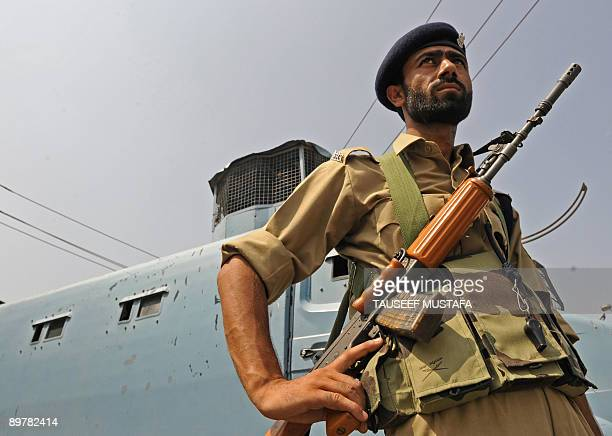 Indian Central Reserve Police Force soldiers stand guard outside the Bakshi stadium the main venue for India's Independence day celebrations in...