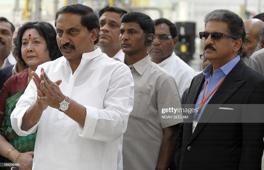 Indian Chairman and Managing Director, Mahindra and Mahindra (MM), Anand Mahindra (R), and Chief Minister of Andhra Pradesh, N.Kiran Kumar Reddy (C) look on during the opening of a new Mahindra manufacturing plant at Zaheerabad in Medak District, around 126 kilometres from Hyderabad on March 6, 2013. Auto-maker Mahindra Mahindra reported 10.99 percent increase in its total sales to 47,824 units in February 2013. The company sold 43,087 units in the same month in 2012, MM said in a statement. AFP PHOTO / Noah SEELAM