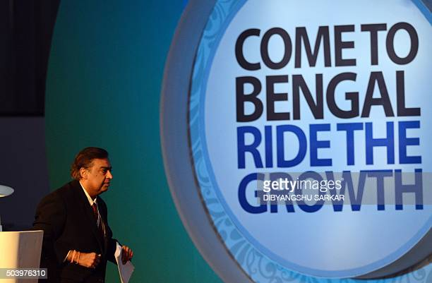 Indian Chairman and Managing Director of Reliance Industries Limited Mukesh Ambani leaves the stage after delivering a speech during the start of the...