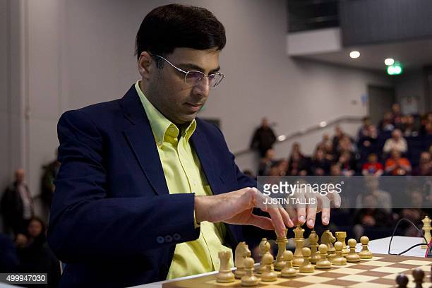 Indian chess player Vishy Anand prepares to make a move during his match against British chess player Michael Adams during the London Chess Classic...