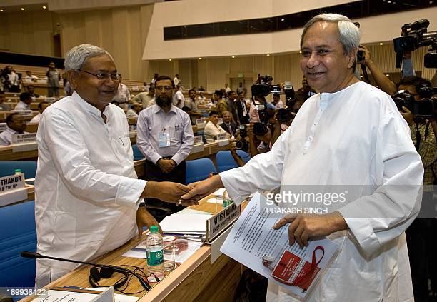Indian Chief Minister of Orissa State Naveen Patnaik shakes hands with Bihar Chief Minister Nitish Kumar during a conference on internal security in...