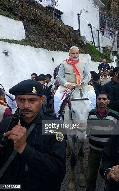 Indian Chief Minister of the western Indian state of Gujarat and Bharatiya Janata Party prime ministerial candidate Narendra Modi rides as horse...
