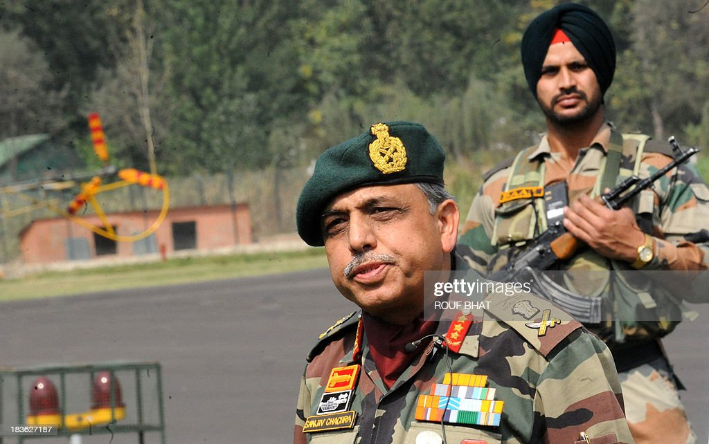 Indian Chief of Northern Command, Lt General Sanjiv Chachra, speaks during a press conference at the Army headquarters in Srinagar on October 8, 2013. Indian army called off a two-week long battle with suspected rebels killing eight of them near the defacto border in Kashmir that divides the territory between India and Pakistan. AFP PHOTO/ Rouf BHAT