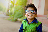 Indian child wear eyeglass