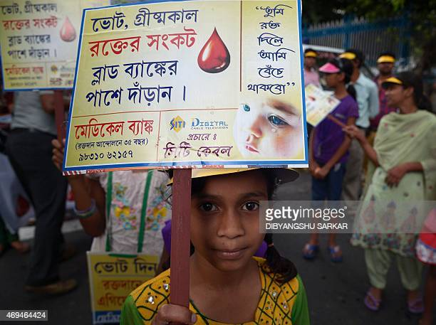 Indian children hold placards as they walk in a rally to promote blood donations in Kolkata on April 12 2015 Blood donation banks get majority of...