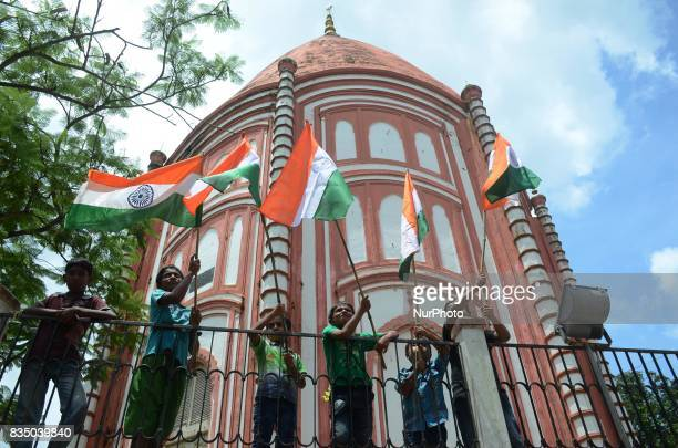 Indian children holds national flag during the Independence Day celebration in Shivnibas Nadia district 95 km from Kolkata India on Friday 18th...