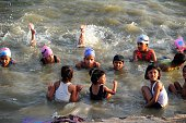 Indian children paddle during swimming coach Satish Rao's annual free summer camp at the Yamuna river at Sangam in Allahabad on June 11 2015 AFP...