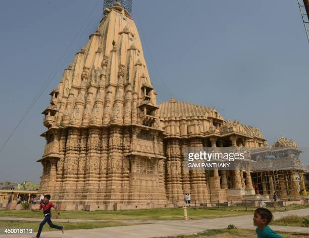 Indian children play outside the Somnath temple located in the Prabhas Patan near Veraval in Saurashtra some 350 kms from Ahmedabad on the eve of...