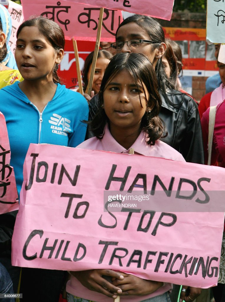 Indian children shout slogans during a protest in New Delhi on December 12 2008 on the Global Day against Child Trafficking Child Trafficking is a...