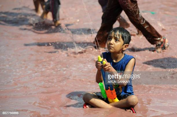 Indian children sprinkle colors during Holi celebrations in Chennai on March 13 2017 The Hindu festival of Holi or the 'Festival of Colours' heralds...
