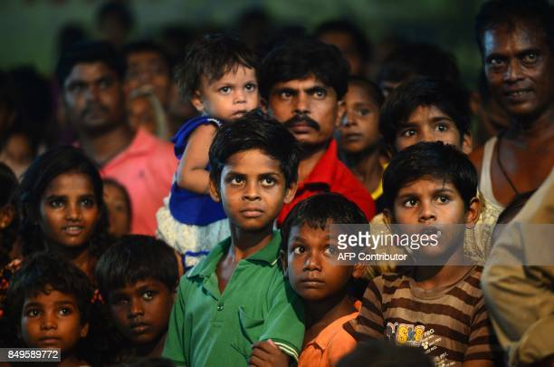 TOPSHOT Indian children watch as young Indian artists perform a traditional Ram Leela drama which narrates the life of Hindu god Rama as they...
