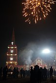 Indian Christian devotees watch a fireworks display outside St Peter's Church in Allahabad on December 24 on Christmas Eve Despite Christians forming...