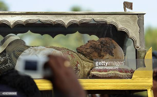 Indian Christians carry the remains of St Francis Xavier towards the Se Cathedral during a procession in Goa on November 22 2014 The 17th exposition...