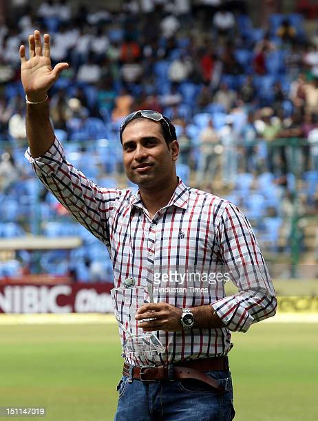 Indian cicketer VVS Laxman waves during his felicitation ceremony by KSCA during third day of second Test match between India and New Zealand at M...