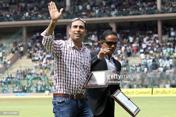 Indian cicketers VVS Laxman and Sunil Joshi pose attend their felicitation ceremony by KSCA during third day of second Test match between India and...