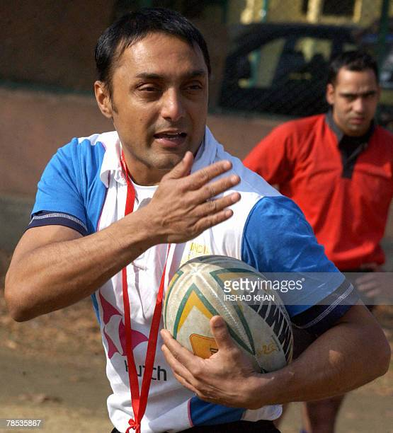 Indian cinema actor Rahul Bose gives a rugby coaching clinic to Kashmiri players in Srinagar 15 December 2007 on the sidelines of the shooting of the...