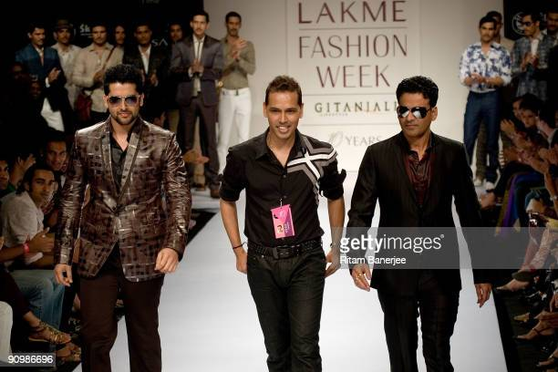Indian Cinema Actors Aftab Shivdasani and Manoj Bajpai showcase creations by Indian designer Troy Costa as they walk with him on the third day of...