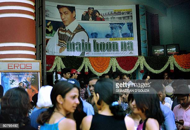 FILMREVIEW Indian cinema goers gather outside a cinema hall which is showing the recently released film 'Main Hoon Na' which features actor Shah Rukh...