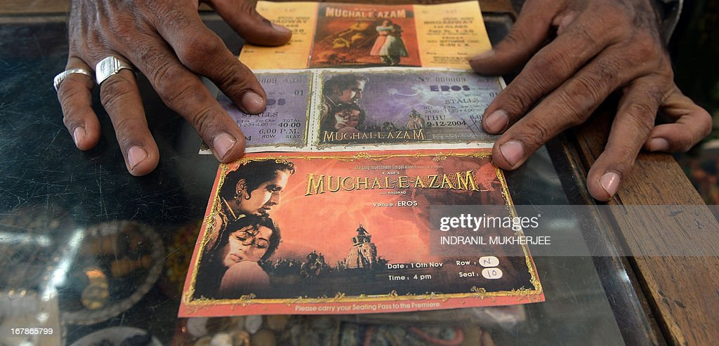 Indian cinema memorabilia dealer Shahid Mansoori displays a print of original movie theatre tickets of epic Indian film Mughal-E-Azam (Mughal Emperor of Emperors) from the black and white version (top and the digitised colour version (centre and bottom) in his shop 'Mini Market' in Mumbai on April 30, 2013. One hundred years after the screening of a black-and-white silent film, India's brash, song-and-dance-laden Bollywood film industry celebrates its centenary later this week. The milestone will be marked with little fanfare, while India will be honoured as 'guest country' at next month's Cannes festival.