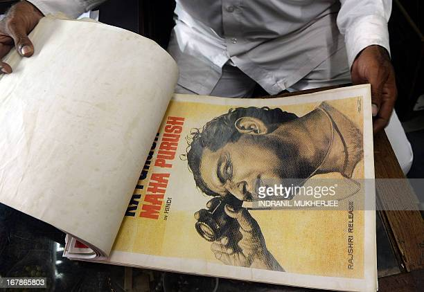 Indian cinema memorabilia dealer Shahid Mansoori looks through his collection of posters for a particular one of Oscar winner Satyajit Ray in his...