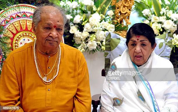 Indian classical flutist Pandit Hariprasad Chaurasia and playback singer Lata Mangeshkar attend the Sathkalaratna Puraskar awards in Mumbai on...