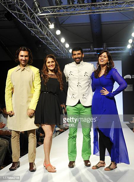 Indian classical musician Rahul Sharma and bollywood actor Aditya Roy Kapur showcase a creation by designer Barkha N Sonzal during the Lakme Fashion...