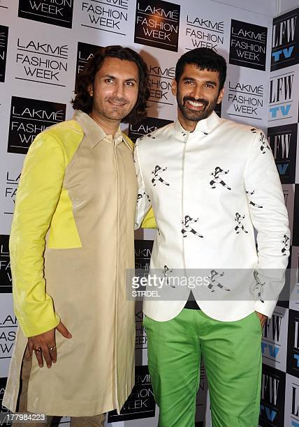 Indian classical musician Rahul Sharma and bollywood actor Aditya Roy Kapur showcase a creation designer by Barkha N Sonzal during the Lakme Fashion...