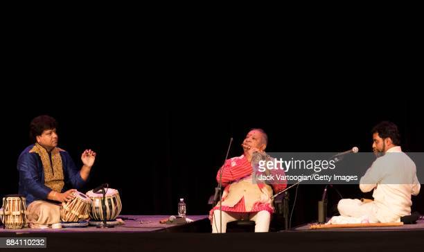 Indian classical musicians from left Subhankar Banerjee on tabla and group leader Hariprasad Chaurasia Jay Gandhi both on bansuri perform during a...
