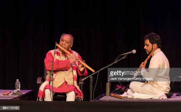 Indian Classical musicians Hariprasad Chaurasia and Jay Gandhi play bansuri as they perform during a World Music Institute concert at the 92nd Street...