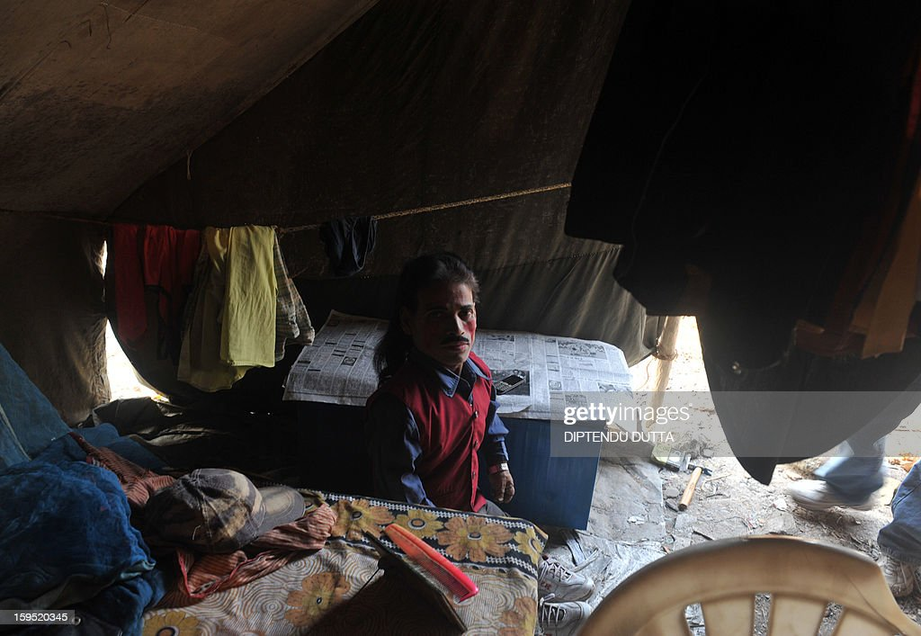 Indian clown Abul Hussain 53, walks through a tent as he prepares for a show at the Kohinoor Circus in Siliguri on January 14, 2013. The Kohinoor Circus, inaugurated in 1988, is one of the most popular as it travels throughout India. At present, there are only ten circuses still active in India whereas in the first half of the 20th century, there were as many as 50 circuses touring the country. AFP PHOTO/ Diptendu DUTTA