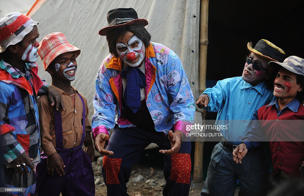Indian clowns share a light moment before preforming at the Kohinoor Circus in Siliguri on January 14, 2013. The Kohinoor Circus, inaugurated in 1988, is one of the most popular as it travels throughout India. At present, there are only ten circuses still active in India whereas in the first half of the 20th century, there were as many as 50 circuses touring the country. AFP PHOTO/ Diptendu DUTTA