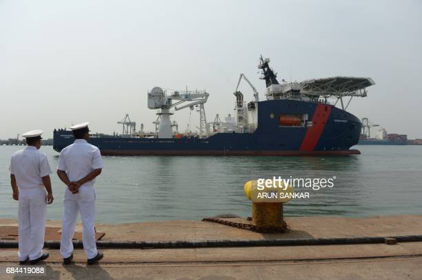 Indian coast guard personnel stand guard as Australian Border Force Cutter 'Ocean Shield' arrives at port in Chennai on May 18 2017 Australian Border...