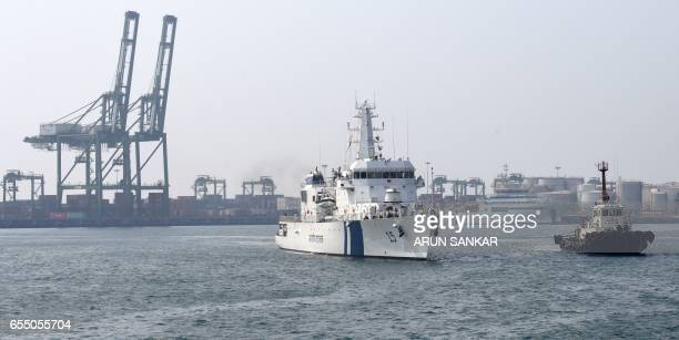 Indian Coast Guard Ship Shaunak a new offshore patrol vessel is escorted by a tug as she arrives at port in Chennai on March 19 making her maiden...