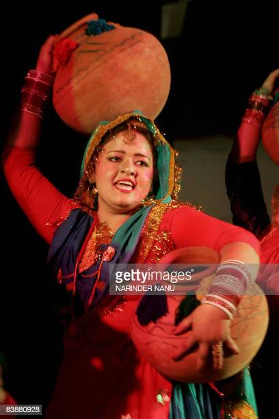 Indian college girls perform the traditional Punjabi dance the 'Giddha' during the InterZonal Youth festival competition of the Punjabi cultural...