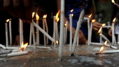 Indian college students participate in a candlelight vigil in memory of those who died and were injured by the bomb blasts in Mumbai on July 16 2011...