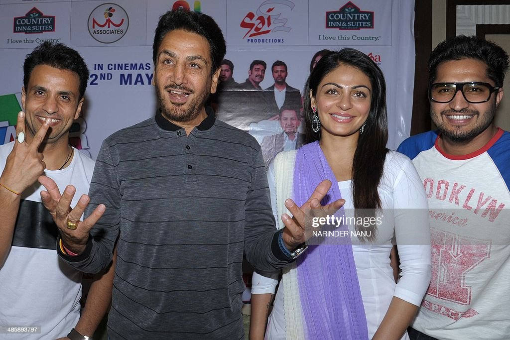 Indian comedian Rajiv Thakur and Punjabi actors and singers Gurdas Maan Neeru Bajwa and Jassi Gill pose for a photograph during a promotional event...