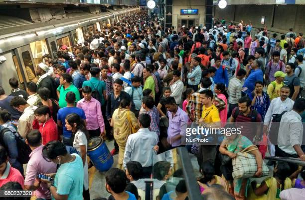Indian commuters make their way through a metro station at rush hour in New Delhi on May 8 2017 Delhi Metro's yellow line Services Affected after...