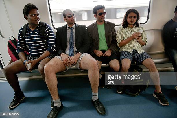 Indian commuters stripped to their underpants participate in a No Pants Subway Ride on the metro in Bangalore on January 12 2014 The No Pants Subway...