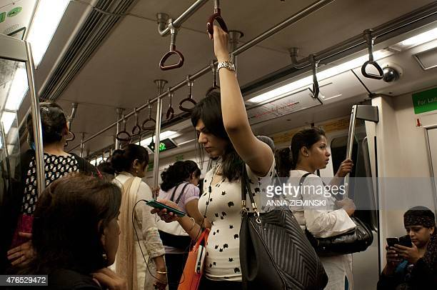 Indian commuters travel in the compartment reserved for women on the metro in New Delhi on June 10 2015 With the first stretch of the Delhi Metro...