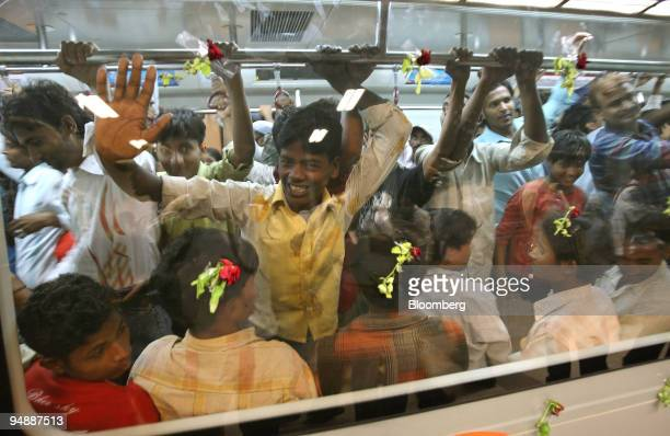 Indian commuters travel on a Delhi Metro Rail Corp train in New Delhi India on Wednesday June 4 2008 Elattuvalapil Sreedharan popularly known as...