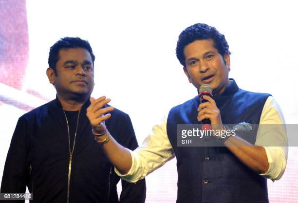 Indian composer singer and musician AR Rahman and former cricketer Sachin Tendulkar talk onstage during a promotional event for the forthcoming film...