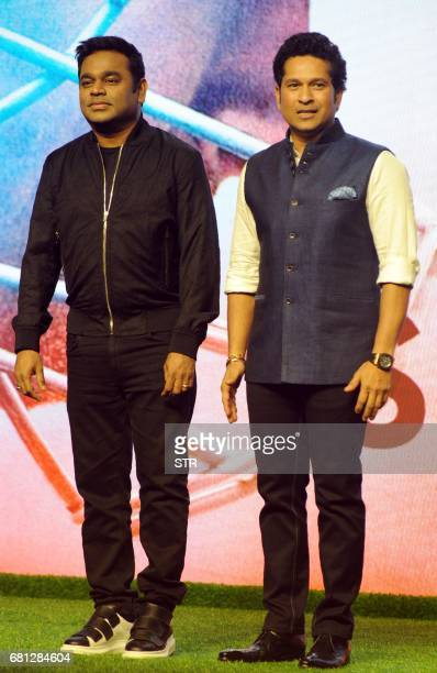 Indian composer singer and musician AR Rahman and former cricketer Sachin Tendulkar pose for a photograph during a promotional event for the...