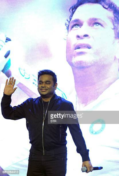 Indian composer singer and musician AR Rahman waves during a promotional event for the forthcoming film 'Sachin A Billion Dreams' in Mumbai on late...