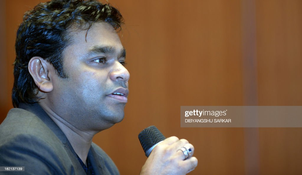 Indian composer, singer, song-writer, music producer, and multi-instrumentalist, A.R. Rahman speaks during a press conference to announce the 'Rahmanishq' music concert in Kolkata on September 28, 2013. Music lovers are waiting for October 1st live concert of this two Academy Awards winner for his work in Slumdog Millionaire. AFP PHOTO / Dibyangshu SARKAR